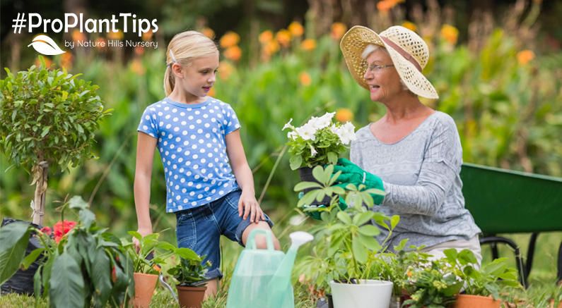 girl and grandmother gardening together