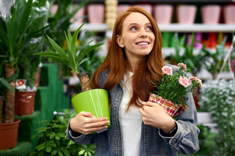 Smiling Girl With Plants